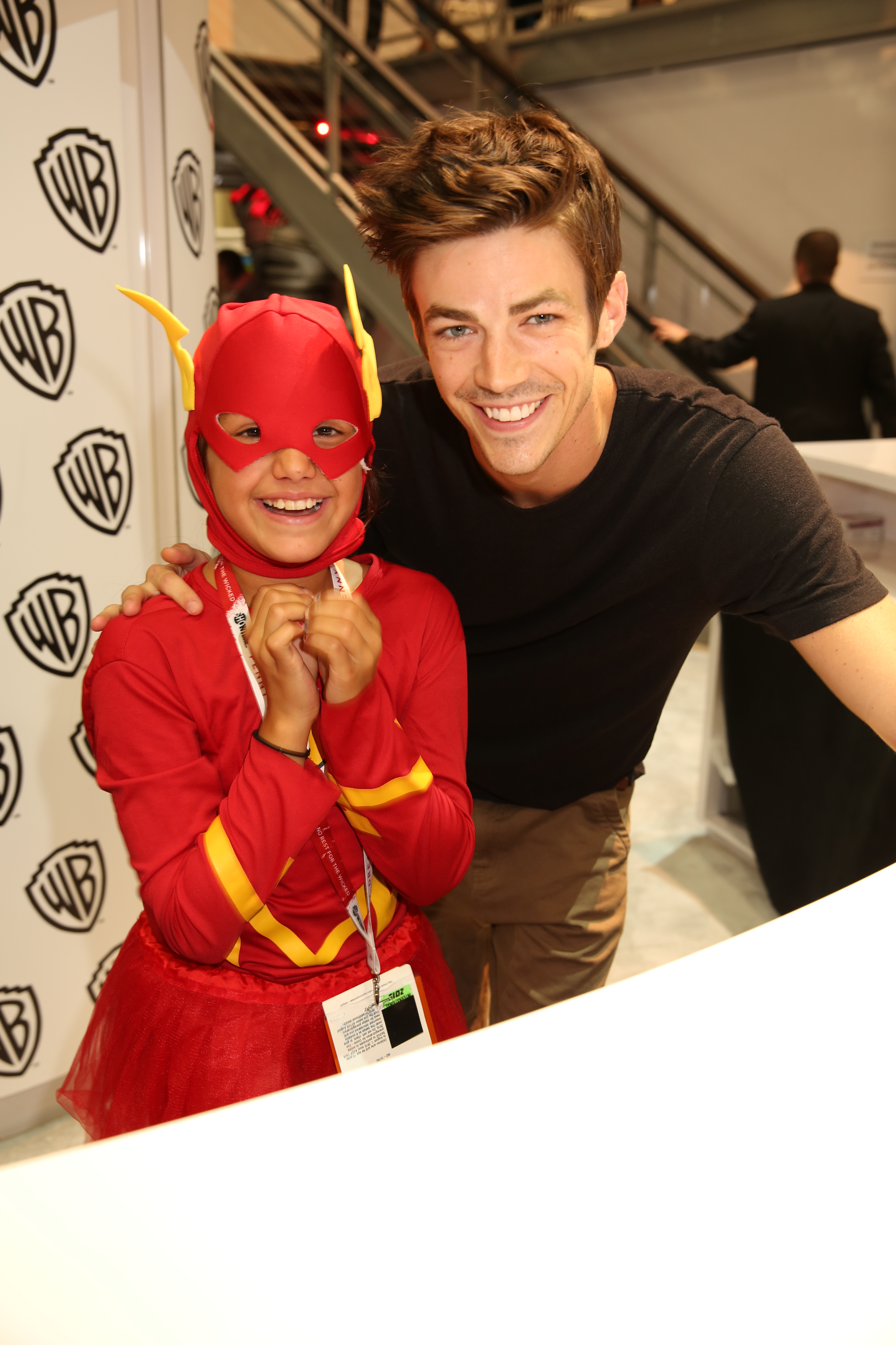 The flash signing a young flash meets his tv counterpart series star grant gustin at the flash signing in the warner bros booth during comic con 2015 wbsdcc 2015 wbei m4hsunfo