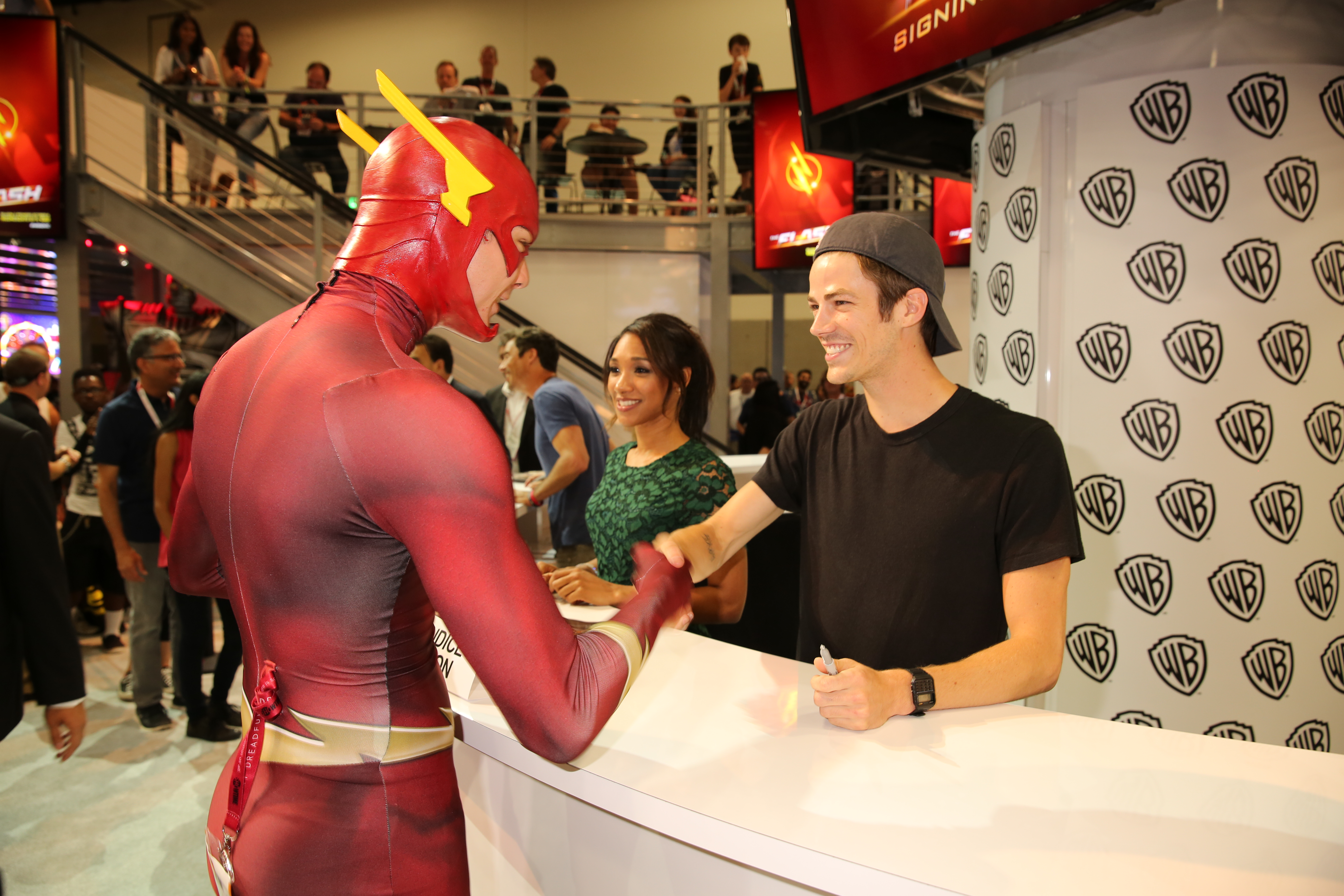The flash signing a super flash fan meets series star grant gustin barry allenthe flash at the flash signing in the warner bros booth during comic con 2015 m4hsunfo